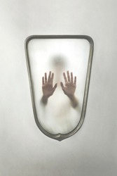 person imprisoned in a mirror, concept of identity crisis