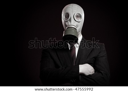 person in a gas mask on a dark background