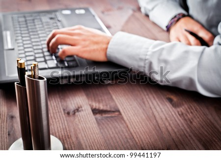 person in the office computer