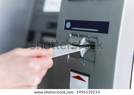 Person insert card to automated teller machine. Cashing non-cash money by individual. #1496539214