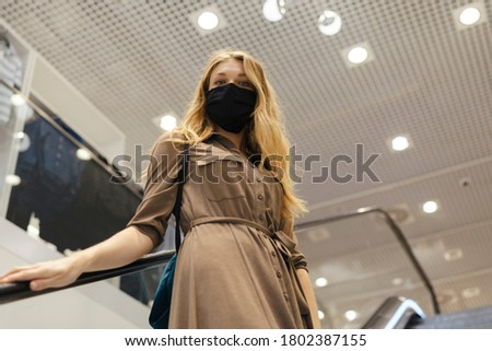 Person is using escalator stairs in the shopping mall Stock photo ©