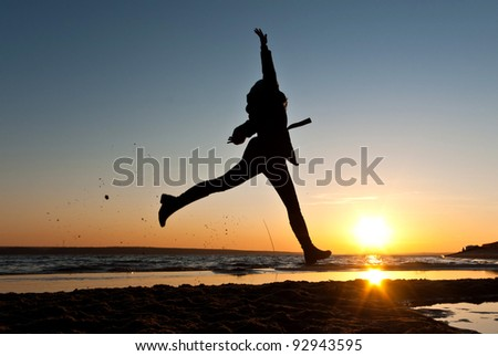 person jump near blue lake with cloudy sky, nature series
