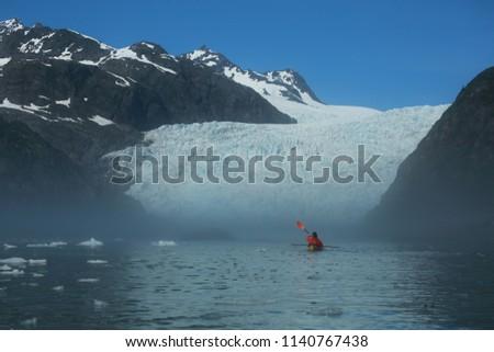 Person Kayaking up to Holgate Glacier in a Hazy Fog