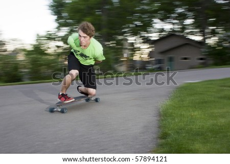 person long boarding around a sharp curve - stock photo