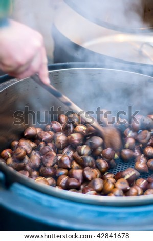 Person makes Roasted Chestnut