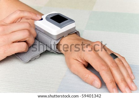 person measuring the blood pressure