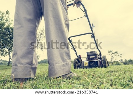 Person mowing a lawn shot from ground level