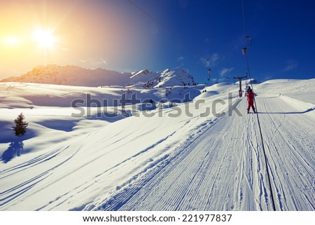 Person on a ski lift in the mountains