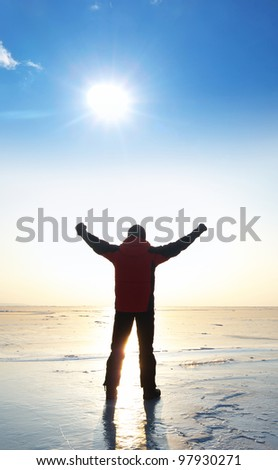 Person on background sun. Bright solar glow and blue sky
