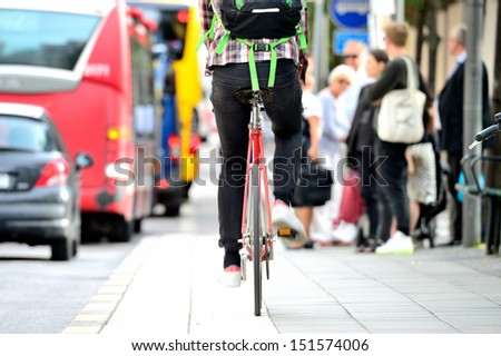 Person on bike in traffic