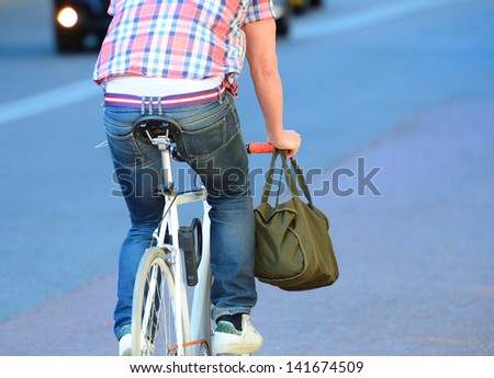 Person on bike seen from behind.