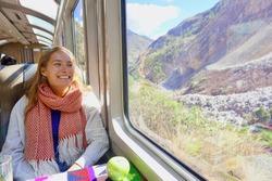 Person on Hiram Bingham Train to Machu Picchu, Peru. Machu Picchu Train. Happy traveler on train to ancient ruin, Machu Picchu, Peru.