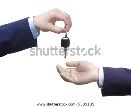 Person passing car keys against white background