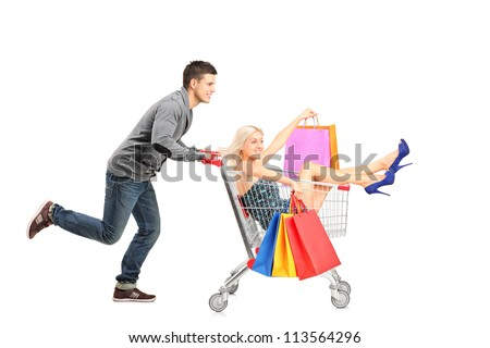 Person pushing a shopping cart, happy woman with bags in it, isolated on white background