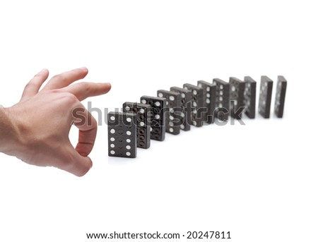 Person pushing domino blocks isolated against white background