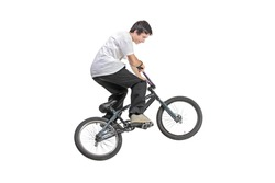 Person riding a bike in jump isolated against white background