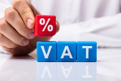 Person's Placing Red Percentage Block Over Vat On White Background