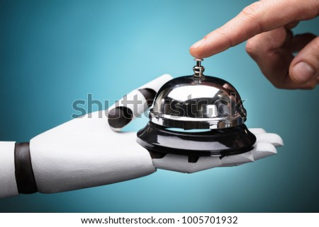 Person's Ringing Service Bell Hold By Robot On Turquoise Background