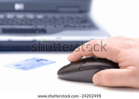 Person shopping online using computer and credit card - stock photo
