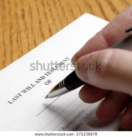 Person signing a will with an elegant pen Stock photo ©