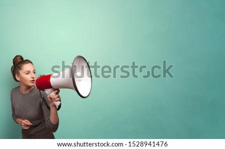 Person speaking in loudspeaker concept