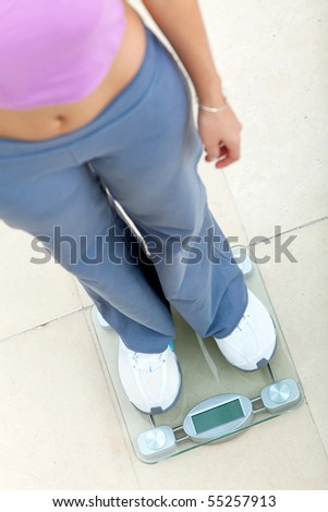 Person standing on a scale - weight loss concepts