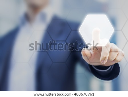 Person touching an hexagonal button on a digital interface. Concept about technology and choices #488670961