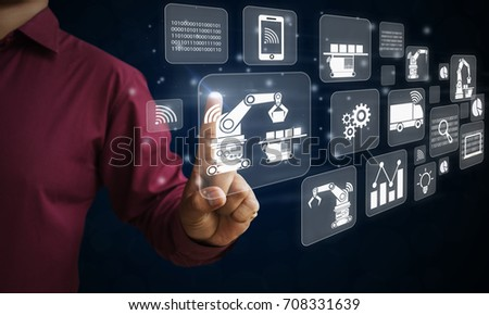 person touching virtual interface smart factory or industry 4.0 concept. with  internet of things connect robots increase automation. #708331639
