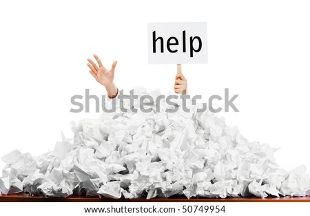Person under crumpled pile of papers with hand holding a help sign isolated against a white background.