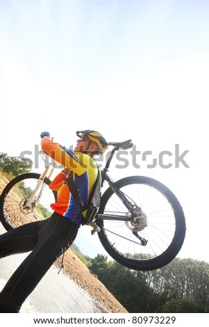 Person up hold bike in mountain bike game.