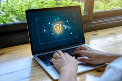 Person using a Laptop Computer with data protection, Cyber security, information safety and encryption concept. internet technology and business concept, Laptop mockup with clipping path on screen.