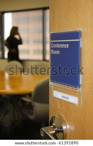 person using conference room in an office