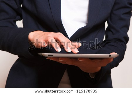 Person Using Modern Tablet Device.