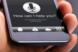 Person Using Voice Recognition Function On Mobile Phone