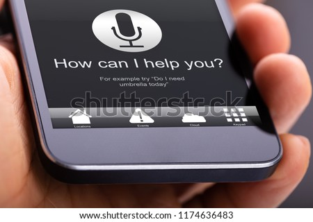 Person Using Voice Recognition Function On Mobile Phone #1174636483