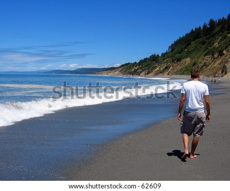 Person walking at Agate Beach, Patrick's Point State Park, CA - stock photo
