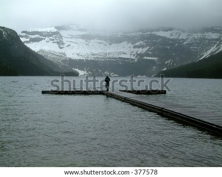 Person walking on a jetty in Waterton lakes NP, Canada.