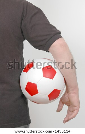 person with football in hand.