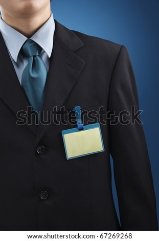 Person with name tag on chest.