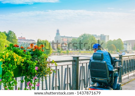 Person with reduced mobility using a personal mobility scooter. Disabled fishing.  improving the quality of life #1437871679