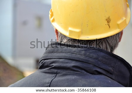person with yellow helmet