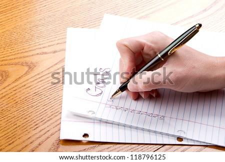 Person writing goals on a paper