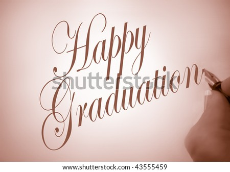 Person writing Happy Graduation in calligraphy in sepia tone