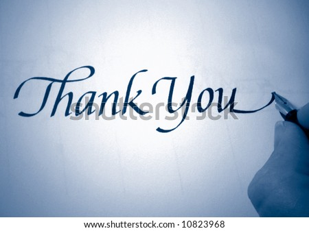 person writing thank you in calligraphy in blue tone