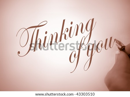 person writing thinking of you  in calligraphy in sepia tone and creative lighting