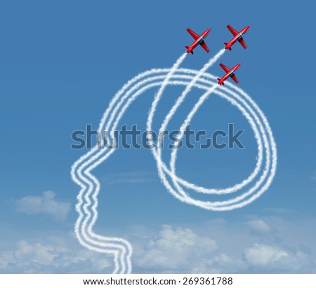 Personal achievement and career aspiration concept as a group of acrobatic jet airplanes performing an air show creating a human head shape for business vision success or learning potential metaphor.