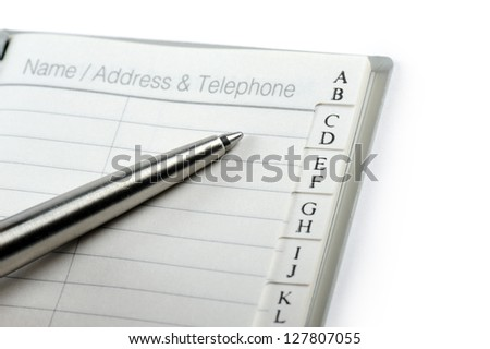 personal address book with pen, on white background