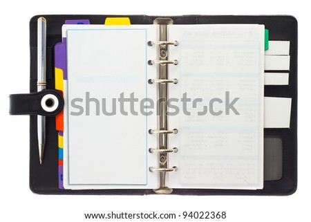 Personal black organizer with pen isolated on white.