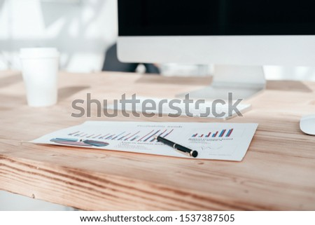 personal computer and financial documents on the office Desk #1537387505