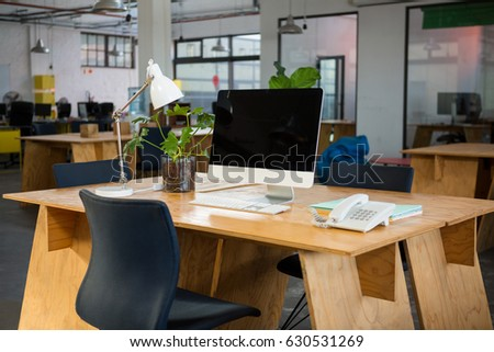 Personal computer and landline on desk in creative office
